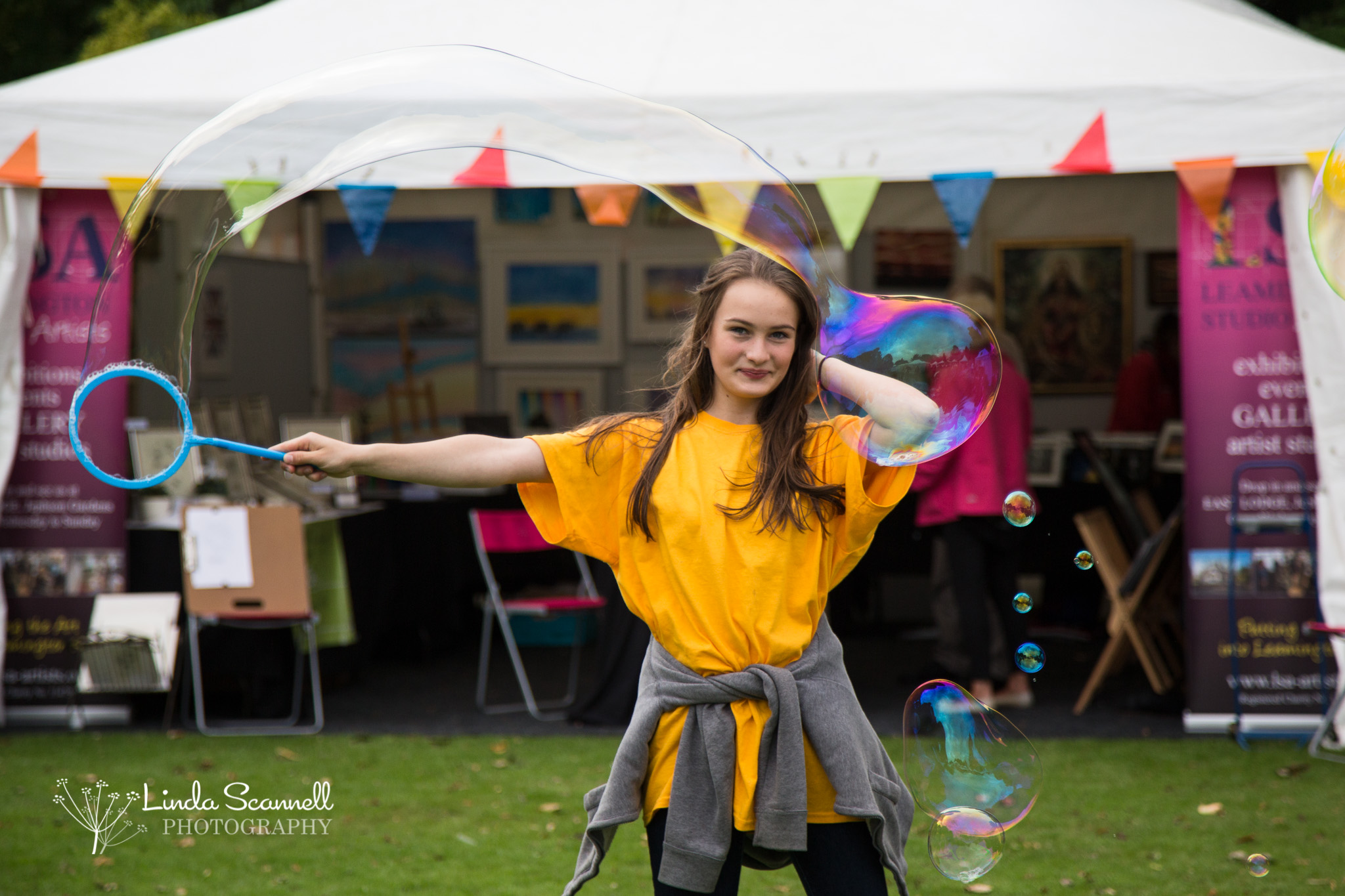 Volunteer with entertainment at Art in the Park 2017