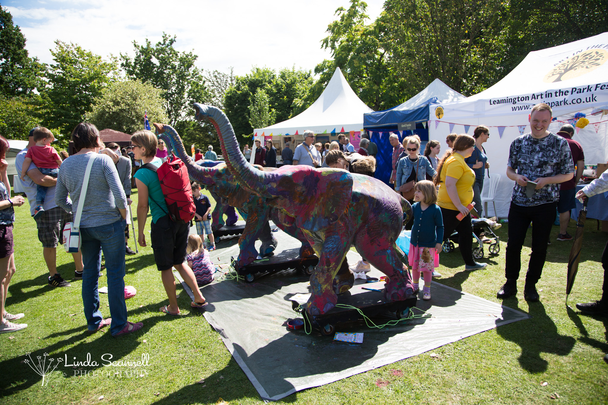 Elephants being painted at Art in the Park, Leamington Spa